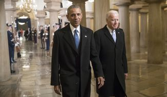 President Barack Obama and Vice President Joe Biden walk through the Crypt of the Capitol in Washington, Friday, Jan. 20, 2017, for Donald Trump's inauguration ceremony. (AP Photo/J. Scott Applewhite, Pool) ** FILE **