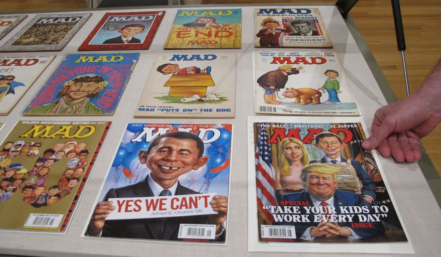A new exhibit celebrating the artistic legacy of MAD magazine that includes several examples of magazines over the years is displayed on Thursday, May 3, 2018, in Columbus, Ohio. Artistically Mad: Seven Decades of Satire opens at the Billy Ireland Cartoon Library & Museum at Ohio State University on Saturday, May 5, and runs through Oct. 21. The exhibit will include original drawings and paintings, displays of vintage MAD magazines and memorabilia such as trading cards and board games. (AP Photo/Andrew Welsh-Huggins)