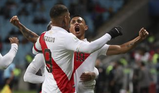 Peru's Victor Yotun, right, celebrates scoring his side's second goal with teammate Paolo Guerrero during a Copa America semifinal soccer match against Chile at the Arena do Gremio in Porto Alegre, Brazil, Wednesday, July 3, 2019. (AP Photo/Ricardo Mazalan)