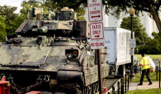 "One of two Bradley Fighting Vehicles is parked nearby the Lincoln Memorial for President Donald Trump's 'Salute to America' event honoring service branches on Independence Day, Tuesday, July 2, 2019, in Washington. President Donald Trump is promising military tanks along with ""Incredible Flyovers & biggest ever Fireworks!"" for the Fourth of July. (AP Photo/Andrew Harnik)"