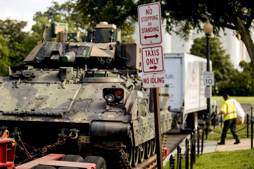 """One of two Bradley Fighting Vehicles is parked nearby the Lincoln Memorial for President Donald Trump's 'Salute to America' event honoring service branches on Independence Day, Tuesday, July 2, 2019, in Washington. President Donald Trump is promising military tanks along with """"Incredible Flyovers & biggest ever Fireworks!"""" for the Fourth of July. (AP Photo/Andrew Harnik)"""
