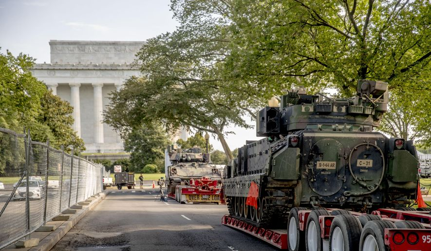 "Two Bradley Fighting Vehicles are parked nearby the Lincoln Memorial for President Donald Trump's ""Salute to America""event honoring service branches on Independence Day, Tuesday, July 2, 2019, in Washington. Trump is promising military tanks along with ""Incredible Flyovers & biggest ever Fireworks!"" for the Fourth of July. (AP Photo/Andrew Harnik)"