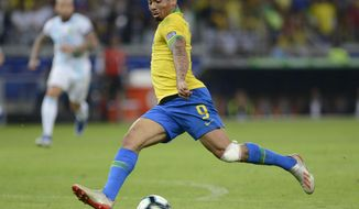 Brazil's Gabriel Jesus gets ready to strike the ball during a Copa America semifinal soccer match against Brazil at Mineirao stadium in Belo Horizonte, Brazil, Tuesday, July 2, 2019. Brazil won the match 2-0 and advanced to the final. (AP Photo/Eugenio Savio)