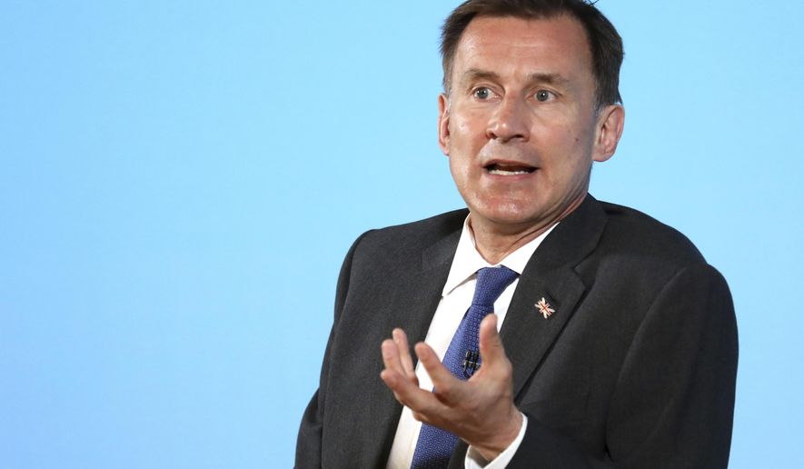 Conservative party leadership contender Jeremy Hunt speaks during a party leadership hustings in Belfast, Northern Ireland Tuesday July 2, 2019. The two contenders, Jeremy Hunt and Boris Johnson face election by party member of Britain's Conservative Party with the winner replacing Prime Minister Theresa May as party leader and UK prime minister. (AP Photo/Peter Morrison)