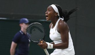 """United States' Cori """"Coco"""" Gauff celebrates after beating Slovakia's Magdalena Rybaikova in a Women's singles match during day three of the Wimbledon Tennis Championships in London, Wednesday, July 3, 2019. (AP Photo/Alastair Grant) ** FILE **"""