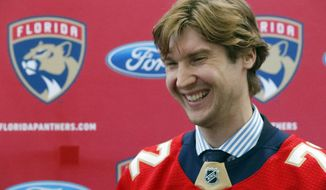Florida Panthers new goaltender Sergei Bobrovsky laughs as he speaks during an NHL hockey news conference, Tuesday, July 2, 2019, in Sunrise, Fla. The Panthers introduced Bobrovsky, Anton Stralman, Brett Connolly and Noel Acciari. The Panthers, New York Rangers and Nashville Predators were winners on Day 1 of NHL free agency. (AP Photo/Wilfredo Lee)