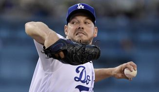 Los Angeles Dodgers' Rich Hill throws during the first inning of the team's baseball game against the San Francisco Giants on Wednesday, June 19, 2019, in Los Angeles. (AP Photo/Mark J. Terrill)
