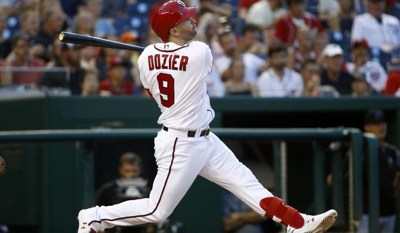 Washington Nationals' Brian Dozier watches his two-run home run in the sixth inning of a baseball game against the Miami Marlins, Wednesday, July 3, 2019, in Washington. (AP Photo/Patrick Semansky) ** FILE **