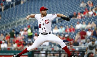 """Washington Nationals starting pitcher Stephen Strasburg throws to the Miami Marlins in the fourth inning of a baseball game, Wednesday, July 3, 2019, in Washington. Strasburg threw an """"immaculate inning"""" in the fourth. (AP Photo/Patrick Semansky)"""