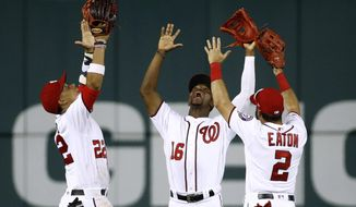 Washington Nationals outfielders Juan Soto, from left, Victor Robles and Adam Eaton celebrate after a baseball game against the Miami Marlins, Wednesday, July 3, 2019, in Washington. Washington won 3-1. (AP Photo/Patrick Semansky) ** FILE **