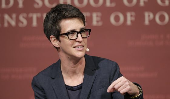 "In this Oct. 16, 2017, file photo, MSNBC television anchor Rachel Maddow, moderates a panel at a forum called ""Perspectives on National Security"" at the John F. Kennedy School of Government, on the campus of Harvard University, in Cambridge, Mass. (AP Photo/Steven Senne, File)"