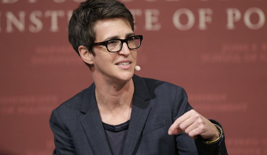 """In this Oct. 16, 2017, file photo, MSNBC television anchor Rachel Maddow, moderates a panel at a forum called """"Perspectives on National Security"""" at the John F. Kennedy School of Government, on the campus of Harvard University, in Cambridge, Mass. (AP Photo/Steven Senne, File)"""