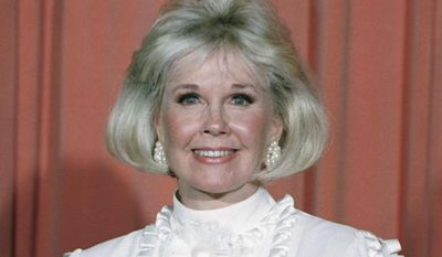 In this Jan. 28, 1989, file photo, actress and animal rights activist Doris Day poses for photos after receiving the Cecil B. DeMille Award she was presented with at the annual Golden Globe Awards ceremony in Los Angeles. Day, whose wholesome screen presence stood for a time of innocence in '60s films, has died, her foundation says. She was 97. The Doris Day Animal Foundation confirmed Day died early Monday, May 13, 2019, at her Carmel Valley, California, home. (AP Photo, File)