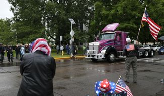 FILE - This June 27, 2019, file photo shows truckers and loggers opposed to the carbon capping bill holding a rally at the Oregon Capitol in Salem, Ore. When Democrats won a supermajority in the Oregon Legislature in the 2018 election, the party was excited. But now Democrats know the limits of that power after Republican senators staged the dramatic nine-day boycott that ended up killing major climate change legislation. (Noble Guyon/The Oregonian via AP, File)