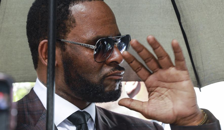 In this June 26, 2019, file photo, musician R. Kelly departs from the Leighton Criminal Court building after a status hearing in his criminal sexual abuse trial in Chicago. (AP Photo/Amr Alfiky, File)