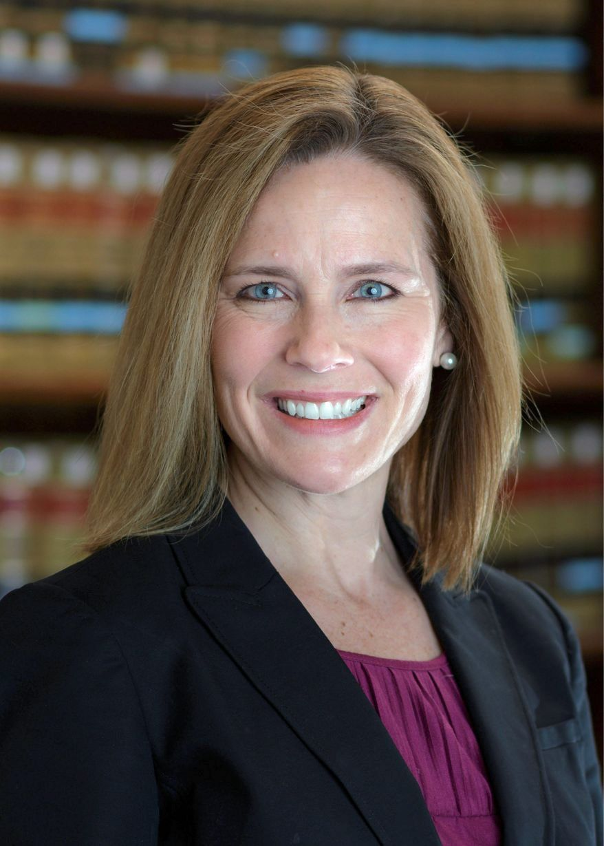 Federal appellate judge Amy Coney Barrett. Ms. Barrett is on President Trump's list of potential Supreme Court appointees, and considered to be a strong contender for the seat vacated by Justice Ruth Bader Ginsburg's death. (Associated Press photo)  **FILE**
