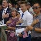 Fifty-one foreign nationals from 28 countries take the Oath of Allegiance to become U.S. citizens on Thursday at Mount Vernon. (Moss Brennan/The Washington Times)