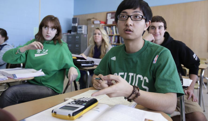 In this Tuesday, March 8, 2011, file photo, Chinese student Minzhe Zou answers a question in statistics class Orono High School in Orono, Maine. Minzhe Zou has credited his year at the public school with helping him get accepted to five U.S. colleges. (AP Photo/Robert F. Bukaty) ** FILE **