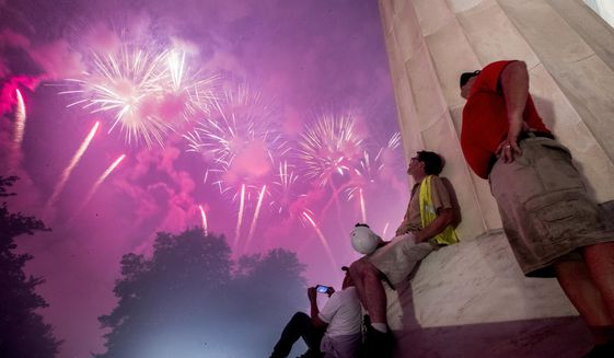 Fireworks seen from the Lincoln Memorial explode over the Potomac River for Independence Day, Thursday, July 4, 2019, in Washington. (AP Photo/Andrew Harnik)  **FiLE**