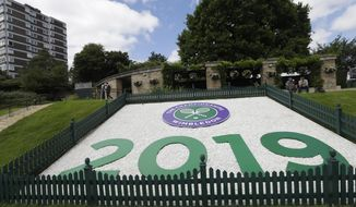 A sign for 2019 is shown on 'Murray Mound' during preparations for the Wimbledon Tennis Championships in London, Sunday, June 30, 2019. (AP Photo/Kirsty Wigglesworth)