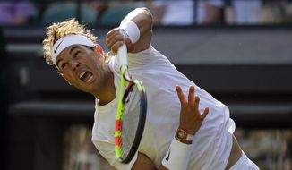 Spain's Rafael Nadal serves to Japan's Sugita Yuichi in a singles match during day two of the Wimbledon Tennis Championships in London, Tuesday, July 2, 2019. (AP Photo/Kirsty Wigglesworth)