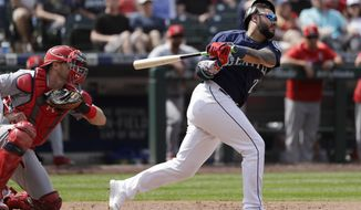 Seattle Mariners' Omar Narvaez strands a pair of runners as he strikes out swinging next to St. Louis Cardinals catcher Matt Wieters, ending the eighth inning of a baseball game Thursday, July 4, 2019, in Seattle. (AP Photo/Elaine Thompson)