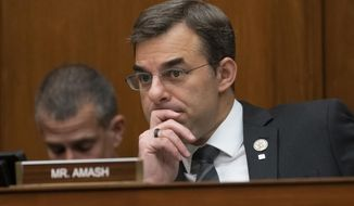 In this June 12, 2019 file photo, Rep. Justin Amash, R-Mich., listens to debate as the House Oversight and Reform Committee considers whether to hold Attorney General William Barr and Commerce Secretary Wilbur Ross in contempt for failing to turn over subpoenaed documents related to the Trump administration's decision to add a citizenship question to the 2020 census, on Capitol Hill in Washington. (AP Photo/J. Scott Applewhite, File )