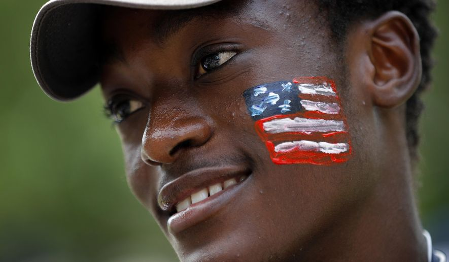 Sebastian Mateus Miguel, an asylum seeker from Angola, attends a picnic for refugees Thursday, July 4, 2019, at Fort Williams Park in Cape Elizabeth, Maine. Volunteers put together the welcoming picnic for asylum seekers housed at the Portland Expo. (AP Photo/Robert F. Bukaty)