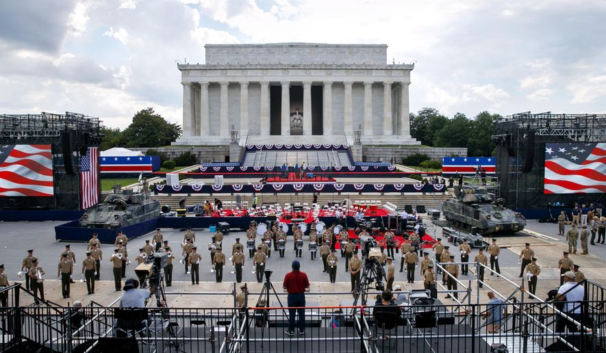 Two Bradley Fighting Vehicles flank the stage being prepared in front of the Lincoln Memorial, Wednesday, July 3, 2019, in Washington, ahead of planned Fourth of July festivities with President Donald Trump. (AP Photo/Jacquelyn Martin)