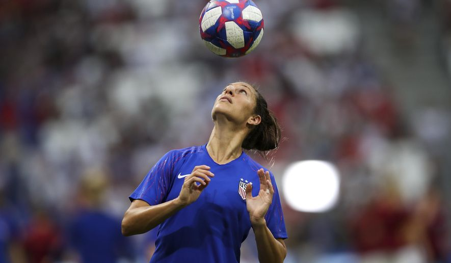 United States' Carli Lloyd warms up before the Women's World Cup semifinal soccer match between England and the United States, at the Stade de Lyon outside Lyon, France, Tuesday, July 2, 2019. (AP Photo/Francisco Seco)