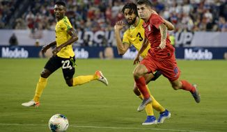 United States midfielder Christian Pulisic (10) moves the ball past Jamaica defender Michael Hector (3) during the first half of a CONCACAF Gold Cup semifinal soccer match Wednesday, July 3, 2019, in Nashville, Tenn. (AP Photo/Mark Zaleski)