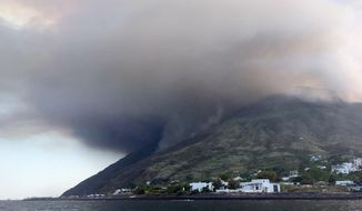 Ash rises into the sky a day after a volcano erupted on the small Sicilian island of Stromboli, southern Italy, early Thursday, 4 July 2019. Civil protection authorities said a hiker was killed during the eruptions on Wednesday which sent about 30 tourists jumping into the sea for safety. (Bartolino Leone/ANSA via AP)
