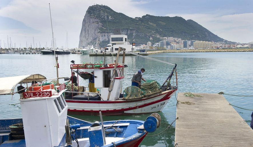 In this file photo taken on May 28, 2012, Spanish fishing boats sit moored in La Linea de Concepcion, Spain, backdropped by the Rock of Gibraltar. The government of Gibraltar says it has detained a large tanker that is believed to be breaching European Union sanctions by carrying a shipment of Iranian crude oil to war-ravaged Syria. In a statement, authorities on the British overseas territory said port and law enforcement agencies, assisted by the Royal Marines, boarded the Grace 1 super tanker early Thursday, July 4, 2019. (AP Photo/Marcos Moreno, File)
