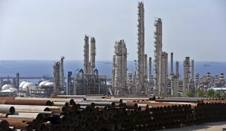 FILE-- This Nov. 19, 2015 file photo shows a general view of a petrochemical complex in the South Pars gas field in Asaluyeh, Iran, on the northern coast of Persian Gulf. When it comes to saving Iran's nuclear deal, Europe finds itself in the impossible situation of trying to salvage an accord unraveling because of the maximalist U.S. sanctions campaign. (AP Photo/Ebrahim Noroozi, File)