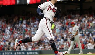 Atlanta Braves shortstop Dansby Swanson (7) rounds third base after hitting a home run in the first inning of the team's baseball game against the Philadelphia Phillies on Thursday, July 4, 2019, in Atlanta. (AP Photo/John Bazemore)