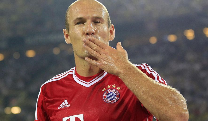 """FILE - In this July 27, 2013, file photo, Bayern's Arjen Robben of the Netherlands reacts during the Supercup final soccer match between Borussia Dortmund and Bayern Munich in Dortmund, Germany. Former Bayern Munich and Netherlands forward Arjen Robben has announced his retirement from soccer. The 35-year-old Robben, who was thought to be looking for a new club after playing his last game for Bayern in May, says in a statement, """"I have decided to put an end to my career as a professional football player. It is without a doubt the most difficult decision I have had to make in my career.""""(AP Photo/Frank Augstein, File)"""