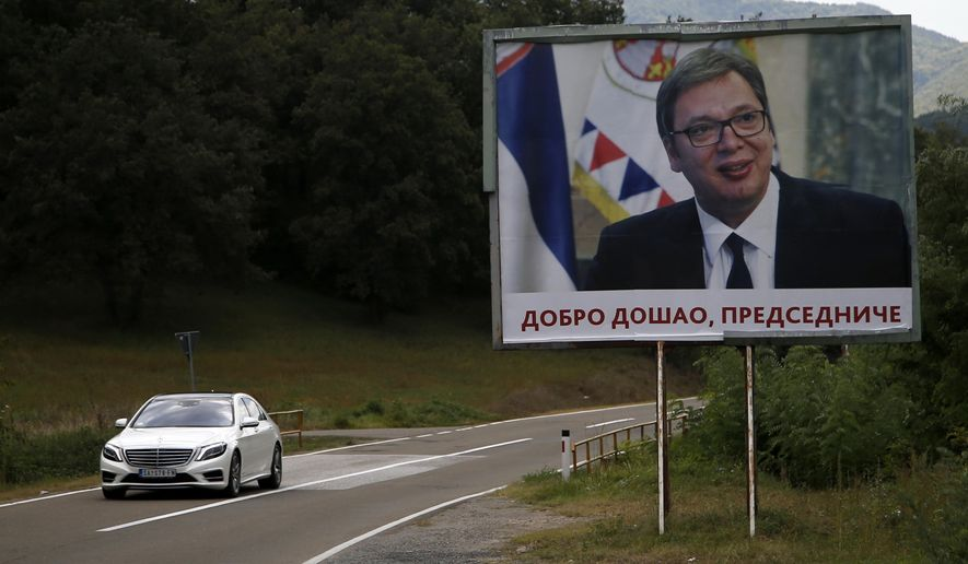 """In this photo taken Friday, Sept. 7, 2018, a car passes by a billboard that reads: '""""Welcome, President"""" and shows Serbian President Aleksandar Vucic, near village of Lesak in northern Kosovo.  Kosovo has temporarily banned Serbian officials from entering the country, triggering angry reaction from Belgrade. (AP Photo/Darko Vojinovic)"""