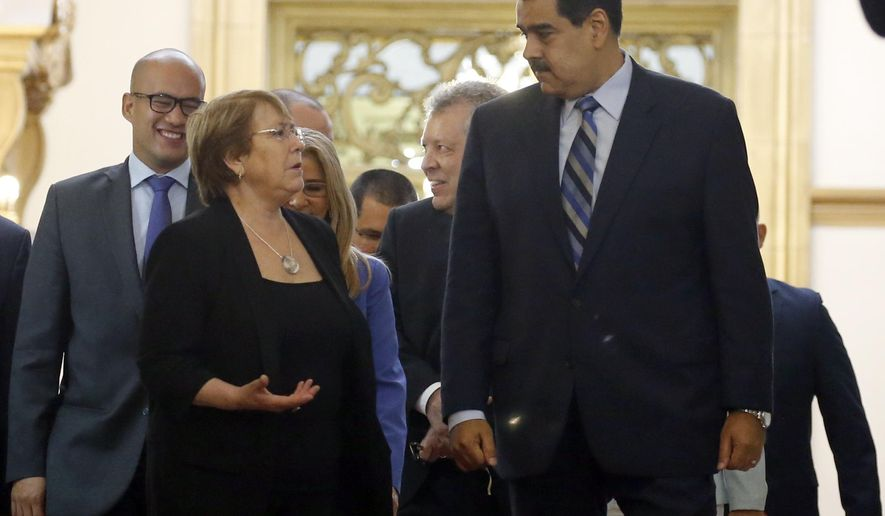 U.N. High Commissioner for Human Rights Michelle Bachelet, left, chats with Venezuela's President Nicolas Maduro, as they walk out of a meeting at Miraflores Presidential Palace, in Caracas, Venezuela, Friday, June 21, 2019. The United Nations' top human rights official is visiting Venezuela amid heightened international pressure on President Maduro. (AP Photo/Ariana Cubillos)