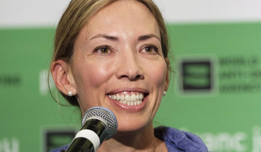 FILE - In this June 5, 2018, file photo, World Anti-Doping Agency athlete committee chairperson Beckie Scott speaks at a news conference following the agency's first Global Athlete Forum in Calgary, Alberta. Scott has received the Order of Canada for her contributions to the fight against doping. The 2002 Olympic champion in cross-country skiing received the honor on Thursday, July 4, 2019. (Jeff McIntosh/The Canadian Press via AP, File)