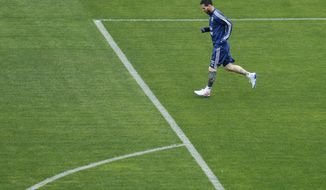 Argentina's Lionel Messi runs during a training session at Pacaembu stadium in Sao Paulo, Brazil, Friday, July 5, 2019. Argentina will face Chile for their Copa America soccer third place match on July 6. (AP Photo/Victor R. Caivano)