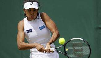 China's Shuai Zhang returns to Denmark's Caroline Wozniacki in a Women's singles match during day five of the Wimbledon Tennis Championships in London, Friday, July 5, 2019. (AP Photo/Kirsty Wigglesworth)