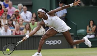 "United States' Cori ""Coco"" Gauff returns to Slovenia's Polona Hercog in a Women's singles match during day five of the Wimbledon Tennis Championships in London, Friday, July 5, 2019. (AP Photo/Ben Curtis) ** FILE **"