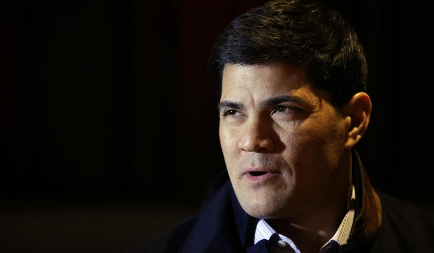 """FILE - In this Jan. 29, 2014, file photo, Tedy Bruschi speaks during an interview at the NFL Super Bowl XLVIII media center in New York. Former New England Patriots linebacker and current ESPN analyst Tedy Bruschi is recovering in a Massachusetts hospital after suffering a second stroke.His family says in a statement the 46-year-old suffered the stroke Thursday and immediately recognized the warning signs of arm weakness, face drooping and speech difficulties. Bruschi was admitted to Sturdy Memorial Hospital in Attleboro, where his family said Friday he was """"recovering well.""""(AP Photo/Matt Slocum) ** FILE **"""