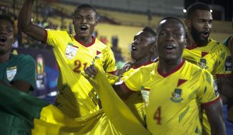 Benin players celebrate after the African Cup of Nations round of 16 soccer match between Morocco and Benin in Al Salam stadium in Cairo, Egypt, Friday, July 5, 2019. (AP Photo/Ariel Schalit)