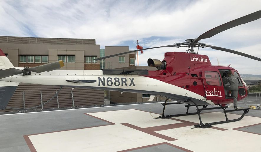 In this undated photograph, the UCHealth medical helicopter sits on the landing pad outside the Medical Center of the Rockies in Loveland, Colo. (Miles Blumhardt/Fort Collins Coloradoan via AP)