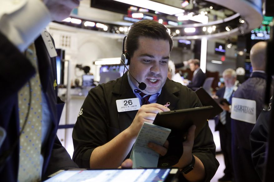 FILE - In this July 1, 2019, file photo trader Joseph Lawler works on the floor of the New York Stock Exchange. The U.S. stock market opens at 9:30 a.m. EDT on Friday, July 5. (AP Photo/Richard Drew, File)