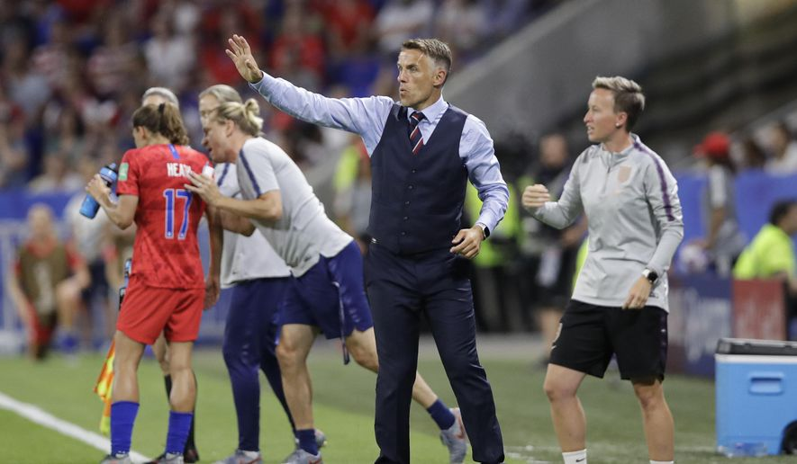 England head coach Philip Neville gestures during the Women's World Cup semifinal soccer match between England and the United States, at the Stade de Lyon, outside Lyon, France, Tuesday, July 2, 2019. (AP Photo/Alessandra Tarantino)