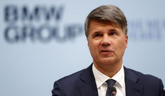 File---Picture taken March 20, 2019 shows CEO of the German car manufacturer BMW, Harald Krueger, attending the earnings press conference in Munich, Germany. (AP Photo/Matthias Schrader)