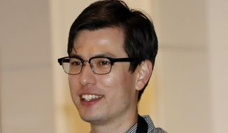 Australian student Alek Sigley arrives at the airport in Tokyo on Thursday, July 4, 2019. The Australian student who vanished in North Korea more than a week ago arrived in Tokyo Thursday, July 4, 2019. (AP Photo/Eugene Hoshiko)
