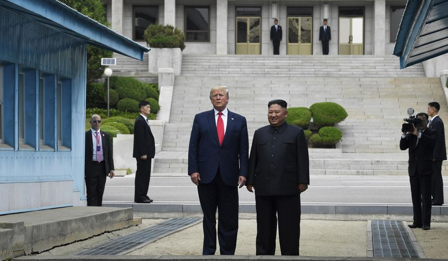 FILE - In this Sunday, June 30, 2019 file photo, U.S. President Donald Trump, center left, and North Korean leader Kim Jong Un stand on the North Korean side of the Demilitarized Zone in Panmunjom. On Friday, July 5, 2019, The Associated Press reported on stories circulating online incorrectly asserting Trump walked into North Korea by himself, without Secret Service or military protection. At background left is Special Agent in Charge Anthony Ornato. (AP Photo/Susan Walsh)